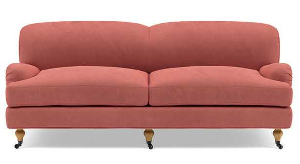 Rose by The Everygirl Sofa with Pink Coral Fabric and Oiled Walnut with Brass Caster legs - Interior Define