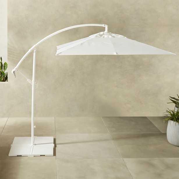 Eclipse White Umbrella with Base - CB2