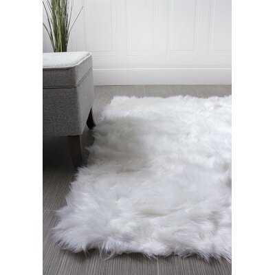 Charlotte Hand-Woven Faux Sheepskin Ivory Area Rug - Wayfair