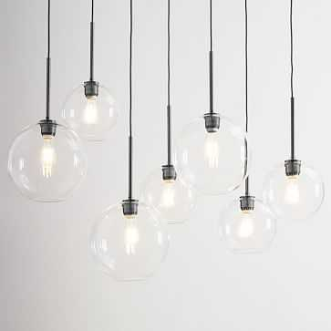 7 Light Linear Globe Chandelier, mixed sizes, Clear Shade, Antique Bronze Canopy - West Elm