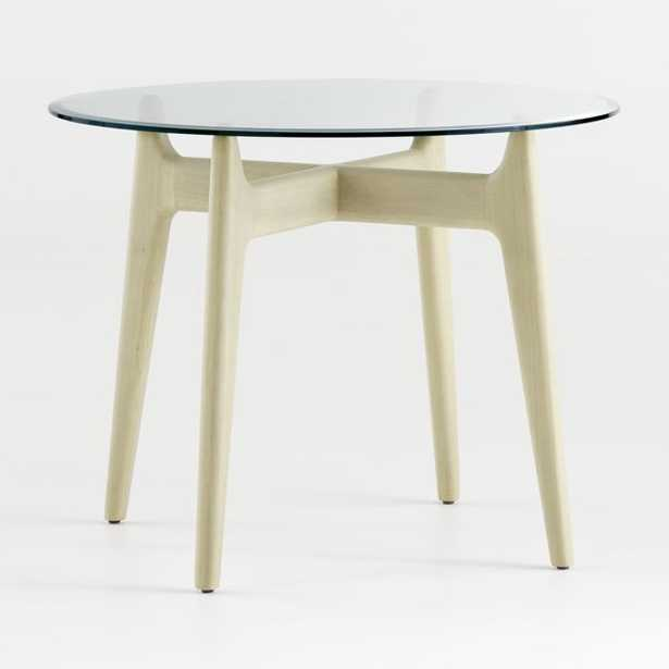 """Tate 38"""" Round Dining Table with Glass Top and Sand Base - Crate and Barrel"""