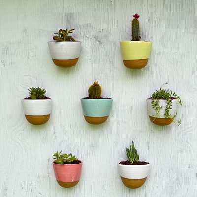 7 stoneware wall planters Save 10% - Etsy