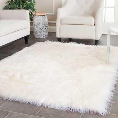 Safavieh Faux Sheep Skin Alexandria Shag Solid Rug - Overstock