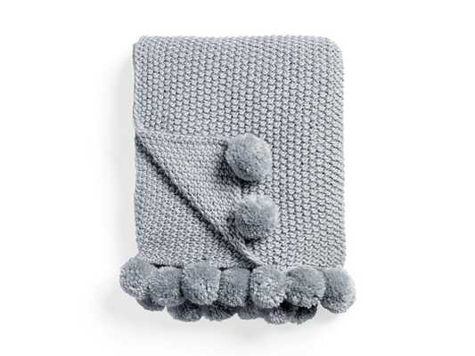 chunky knit throw with pom poms - Arhaus