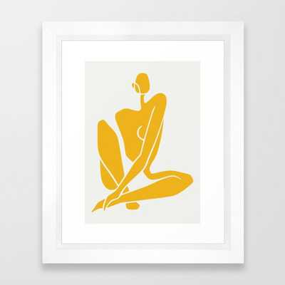 Sitting nude in yellow Framed Art Print - Society6