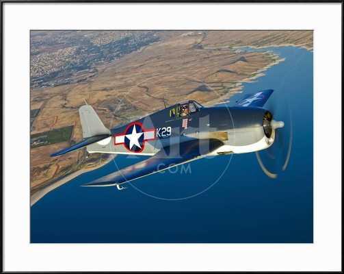 A Grumman F6F Hellcat Fighter Plane in Flight - art.com