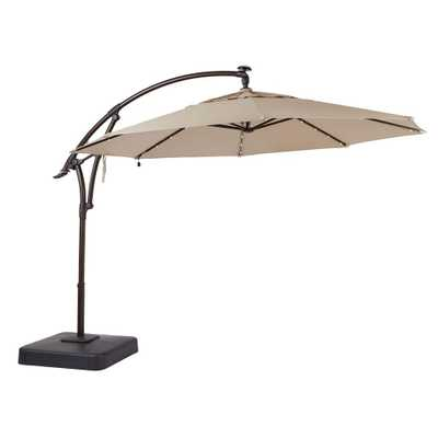 11 ft. LED Round Offset Outdoor Patio Umbrella in Sunbrella Sand - Home Depot