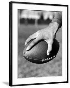 "Holding the Football is Player Paul Dekker of Michigan State -  24"" x 32"" - Chelsea Black - 3.0"" Crisp - Bright White Mat -  Acrylic: Clear - art.com"