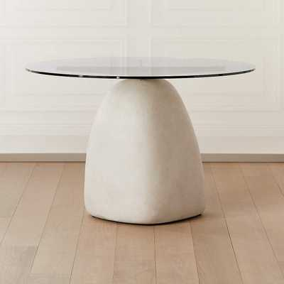 """Stone Ivory Round Dining Table 47"""" - CB2"""