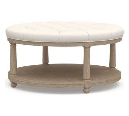 Berlin Upholstered Round Ottoman, Performance Chateau Basketweave Ivory, Seadrift Finish - Pottery Barn