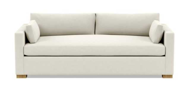 Charly Sofa with White Chalk Fabric, down alternative cushions, and Natural Oak legs - Interior Define