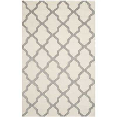 Charlenne Hand-Tufted Ivory Area Rug - Wayfair