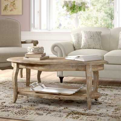 Francoise Solid Wood Coffee Table with Storage - Wayfair