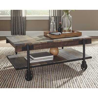 Ardrie Wheel Coffee Table with Storage - Wayfair