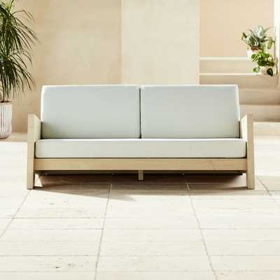 Lunes White Outdoor Loveseat - CB2