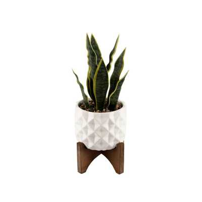 FLORA BUNDA 12.5 in. Faux Snake Plant in White Dimple Pattern Ceramic Pot on Wood Stand - Home Depot