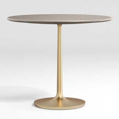 "Nero 36"" Concrete Dining Table with Brass Base - Crate and Barrel"