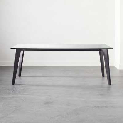 Harper Black Dining Table with Glass Top - CB2