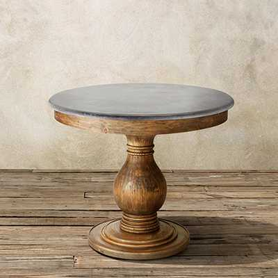 LUCA ROUND PEDESTAL DINING TABLE WITH BLUESTONE TOP - Arhaus
