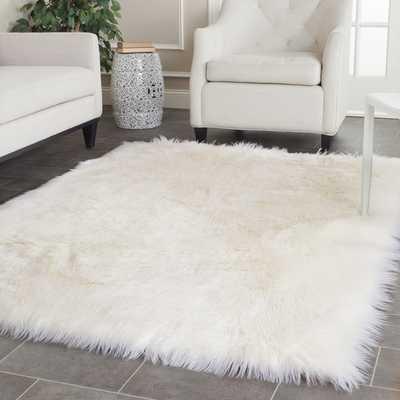 Safavieh Handmade Faux Sheep Skin Ivory Acrylic Rug (6' x 9') - Rugs USA