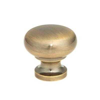 1-1/4 in. Antique Brass Round Cabinet Knob - Home Depot