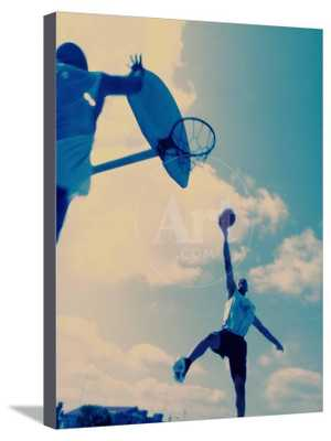 Low Angle View of Two Men Playing Basketball Canvas 18x24 - art.com