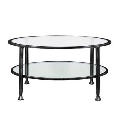Galena Black Metal and Glass Round Cocktail Table, Hand-Painted Black W/Silver Distressing - Home Depot