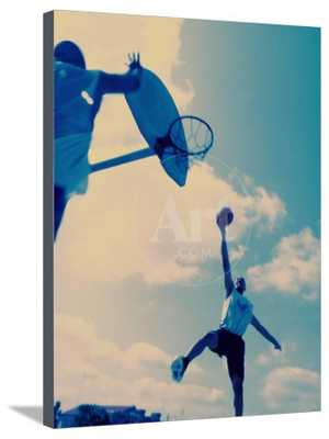 Low Angle View of Two Men Playing Basketball Canvas - art.com