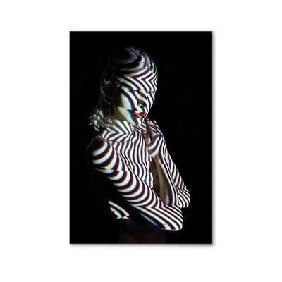 Woman in Abstract Lighting Looking to the Site - Photos.com by Getty Images