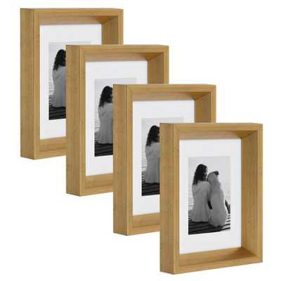 Calter 5 in. x 7 in. matted to 3.5 in. x 5 in. Gold Picture Frame (Set of 4) - Home Depot