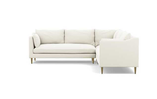 Caitlin by The Everygirl Corner Sectional with Ivory Fabric and Brass Plated legs - Interior Define