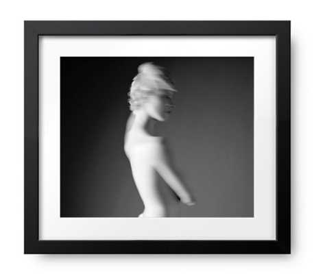Naked young woman (blurred motion, B&W) - Photos.com by Getty Images
