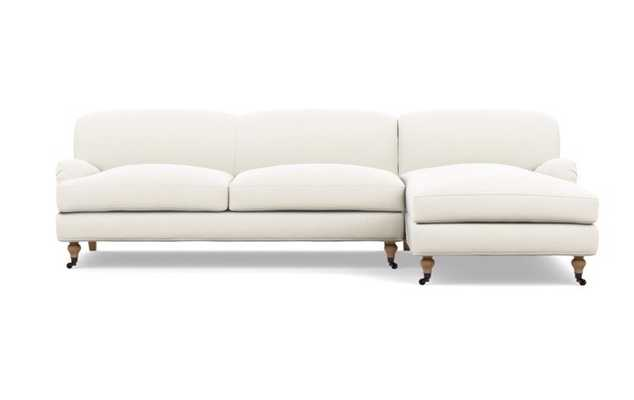 Rose by The Everygirl Chaise Sectional in Ivory Fabric with White Oak with Antiqued Caster legs - Interior Define