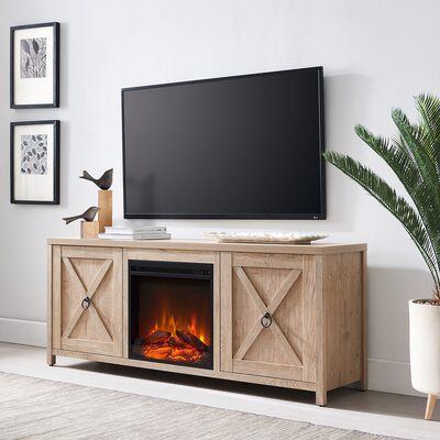 """Bacote TV Stand for TVs up to 65"""" with Electric Fireplace Included"""