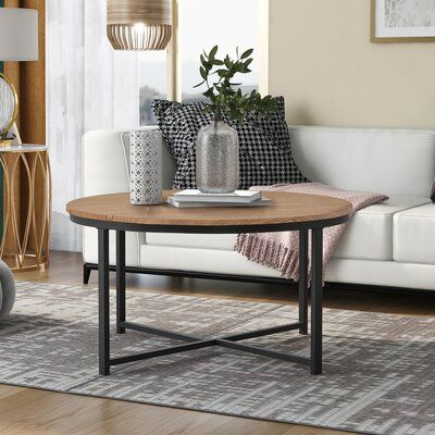 Rustic Design Round Coffee Table Featuring X-Shaped Base And Adjustable Leg