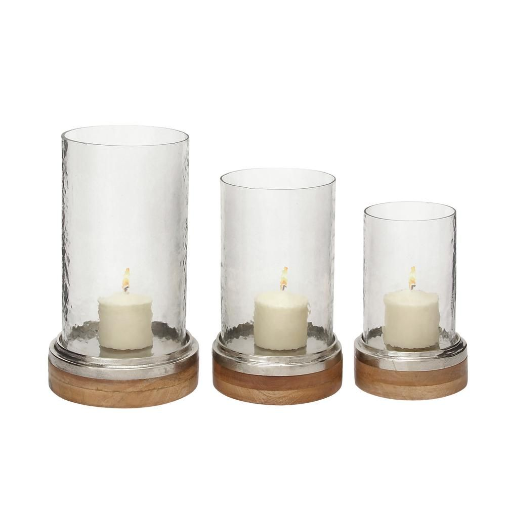 LITTON LANE Silver Aluminum, Brown Wood, and Clear Glass Cylindrical Hurricane Candle Holder (Set of 3), Brown/Tan